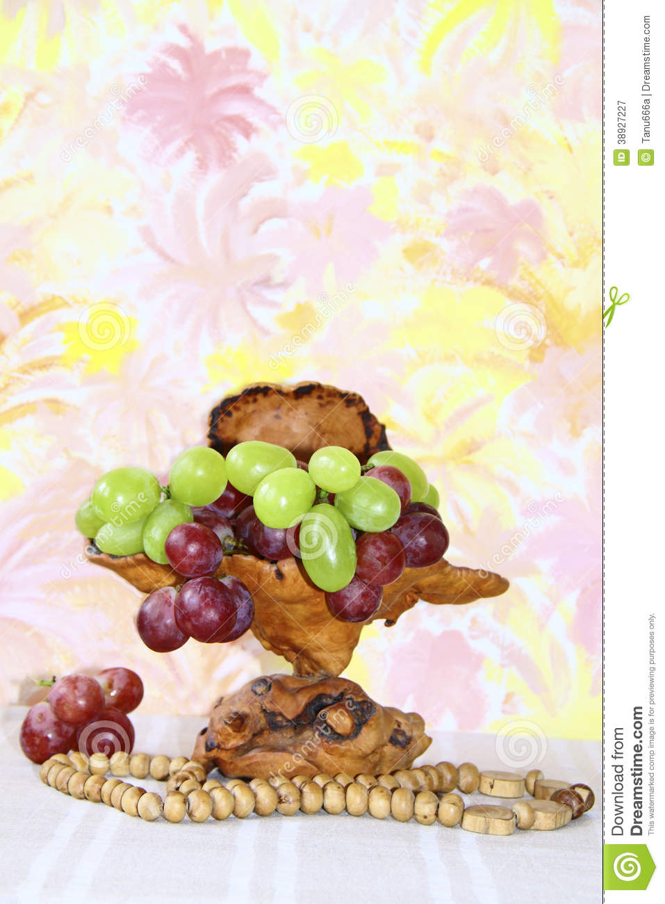 Exclusive wooden vase with pink and green grapes