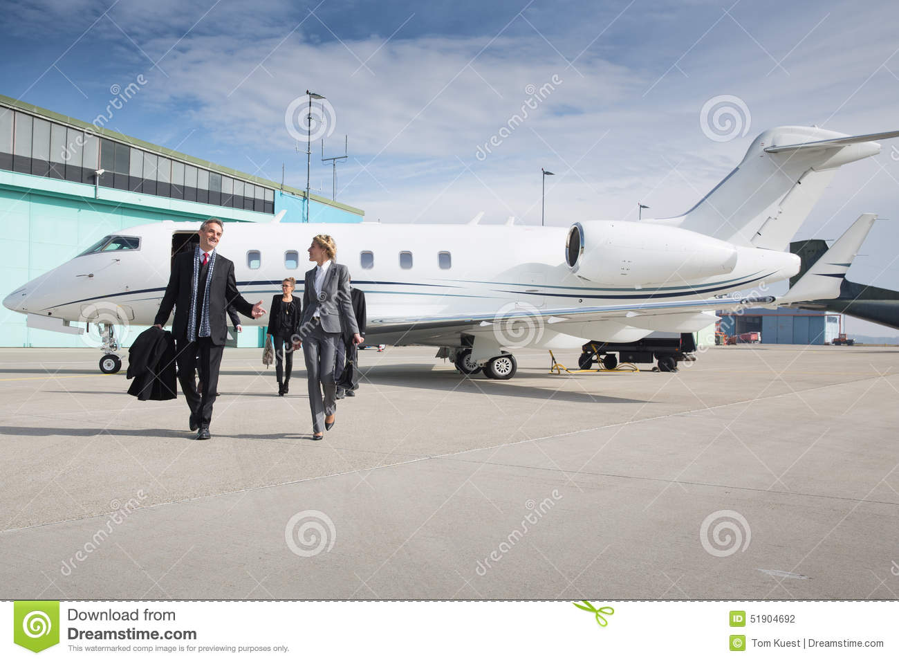 Executive Business Team Leaving Corporate Jet Stock Photo  Image 51904692