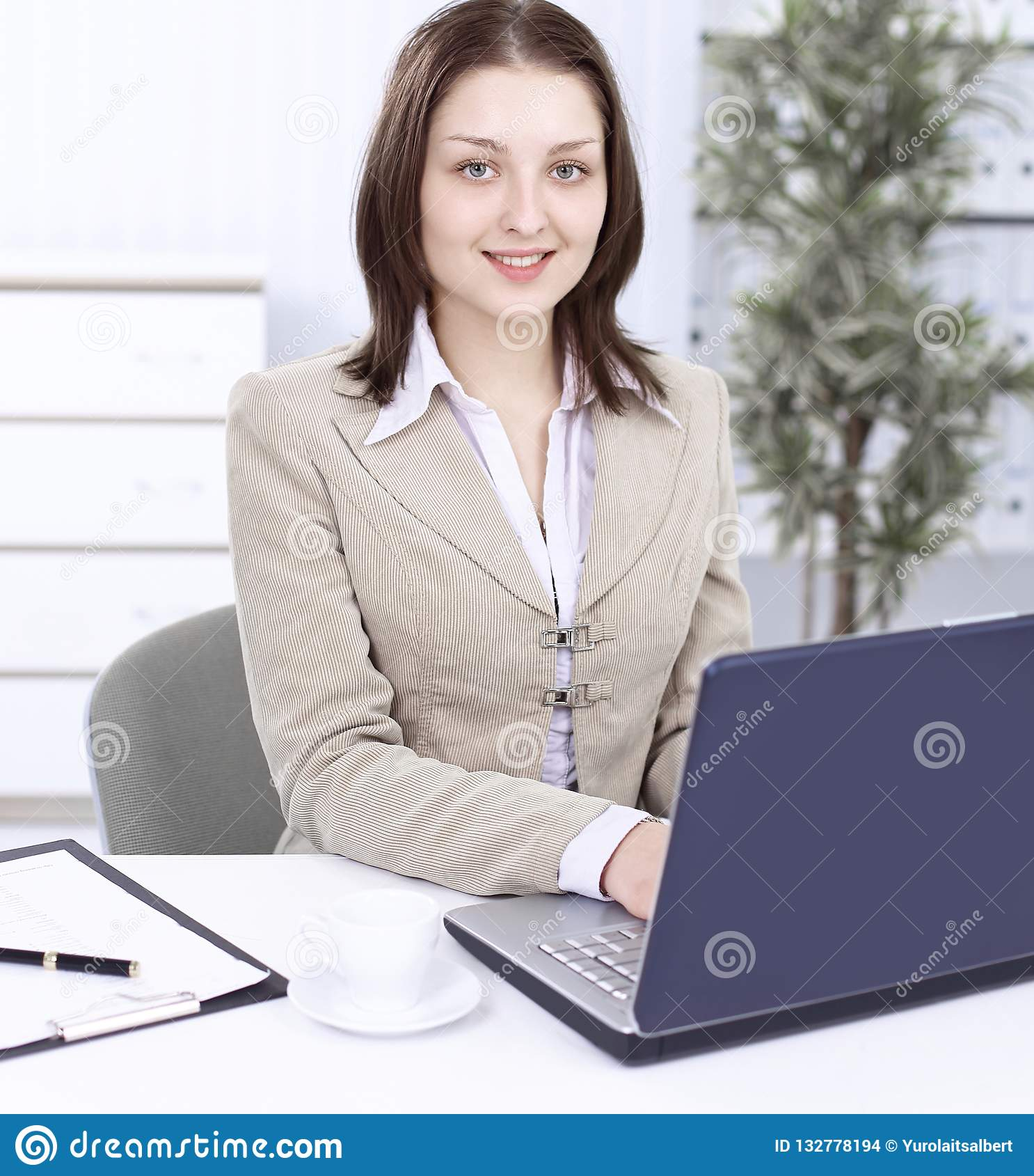 Executive business woman sitting at her Desk