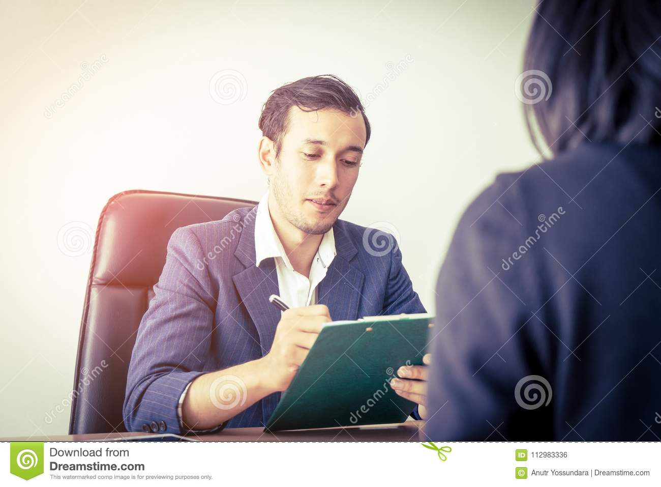 Executive taking note in business job interview