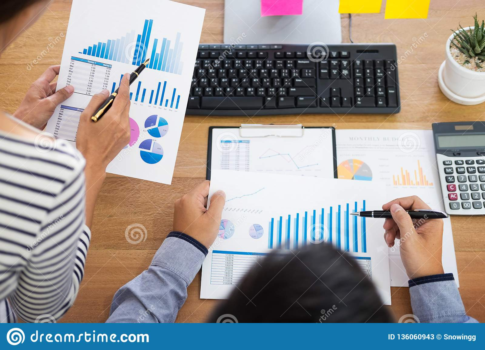 Executives business team designer working together with new startup project with tablet pc and laptop in modern office