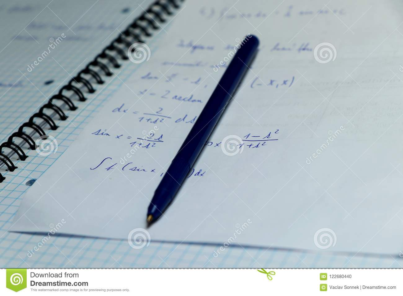 A Exercise Book For Practising Math In Home. Blue Pen With Papers ...