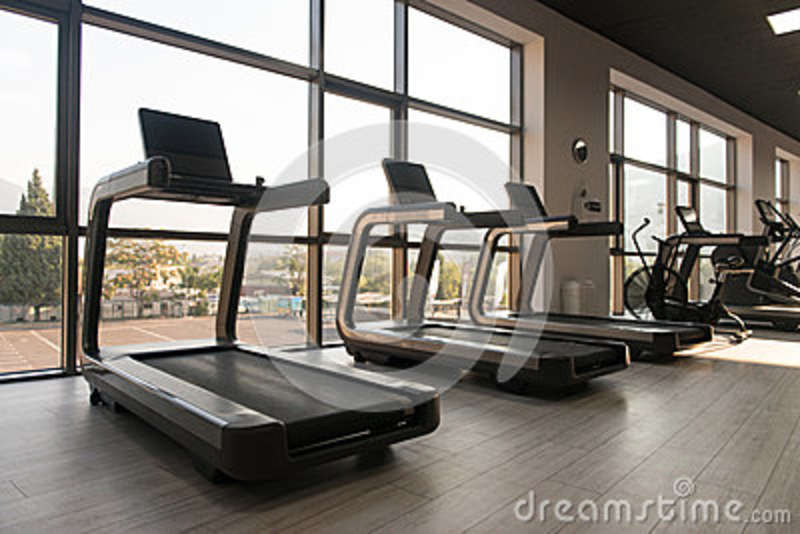 Exercise machines in a modern gym stock photo image of equipment