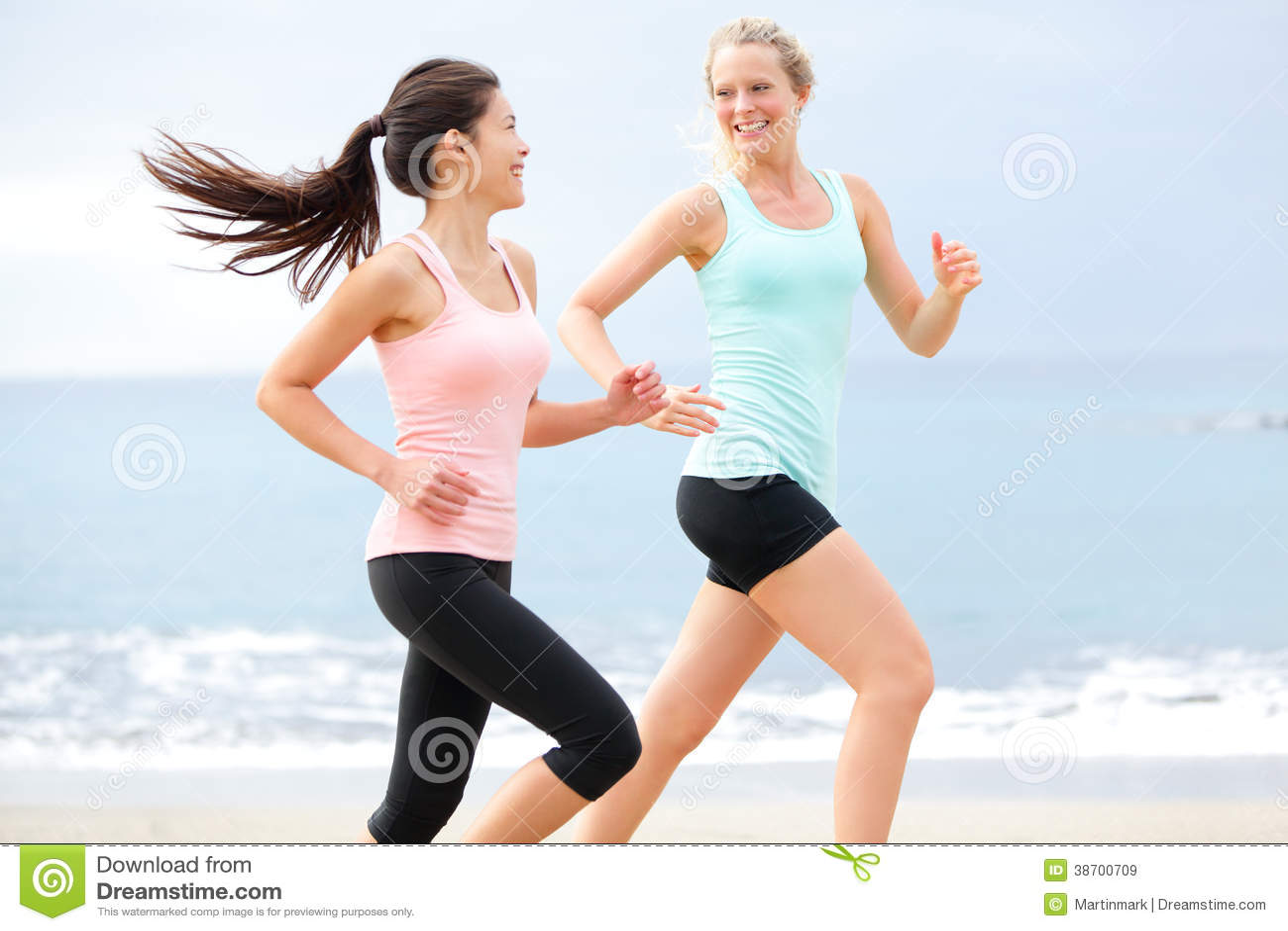 Exercise running women jogging happy on beach