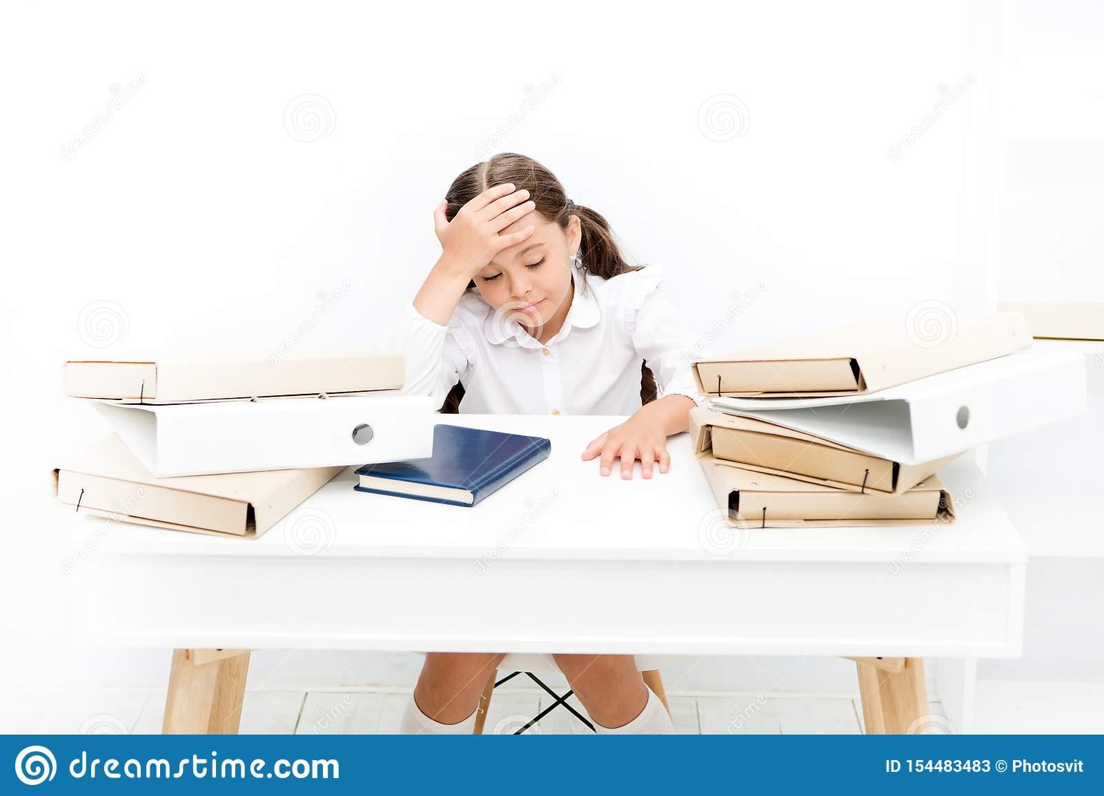 Exhausted girl with workbook and folders. Education. boring lesson. Towards knowledge. small girl on lesson. homework