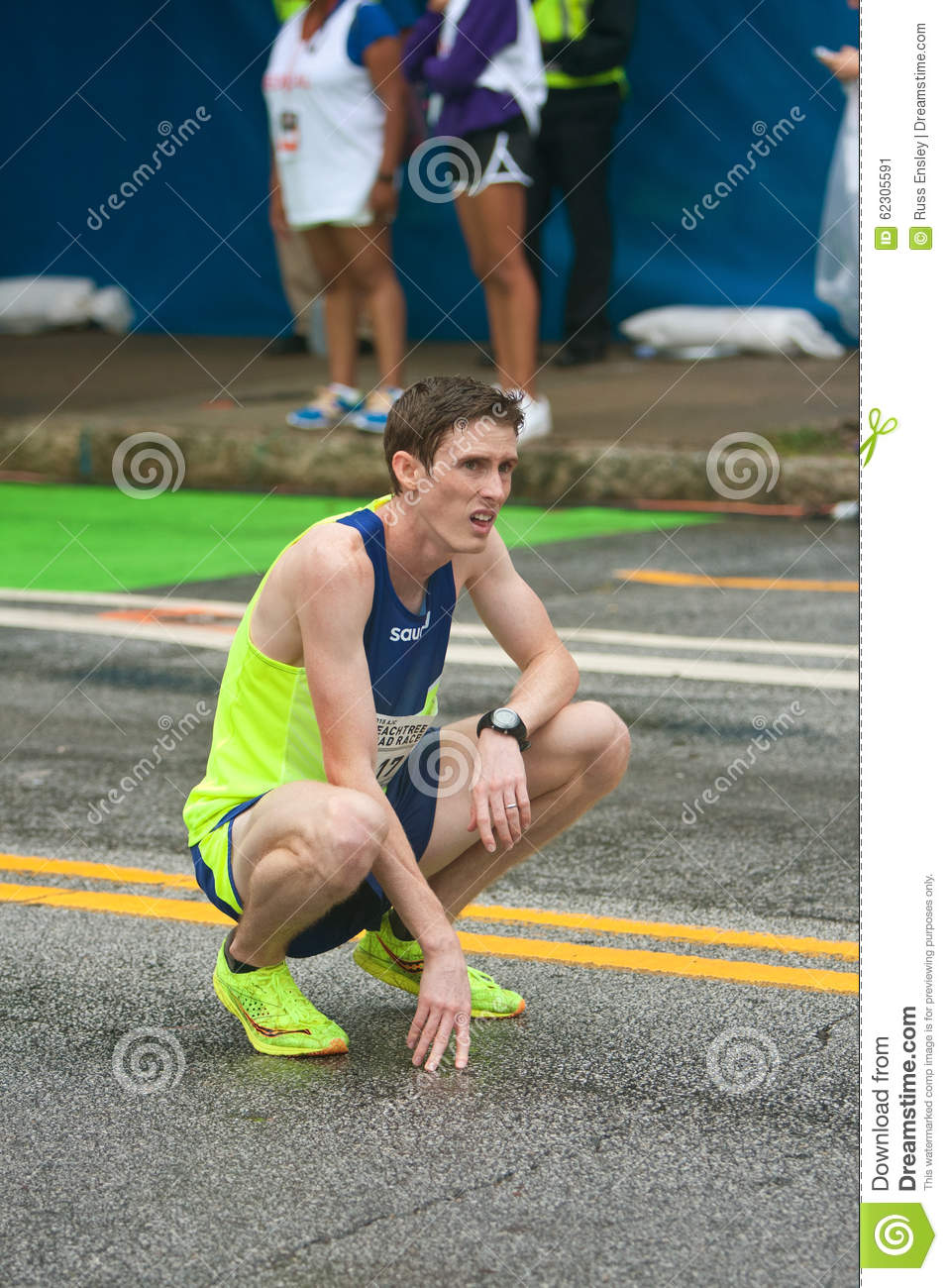 Exhausted Runner Kneels To Catch Breath At Peachtree Road ...