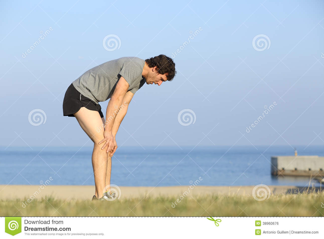 Exhausted Runner Man Resting After Workout Stock Photo ...