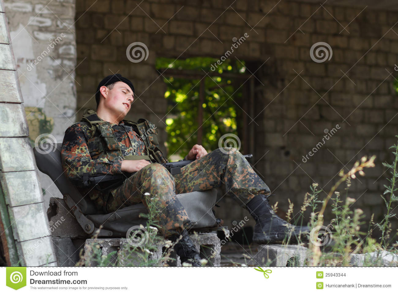 Exhausted Soldier Taki...M Day Soldiers