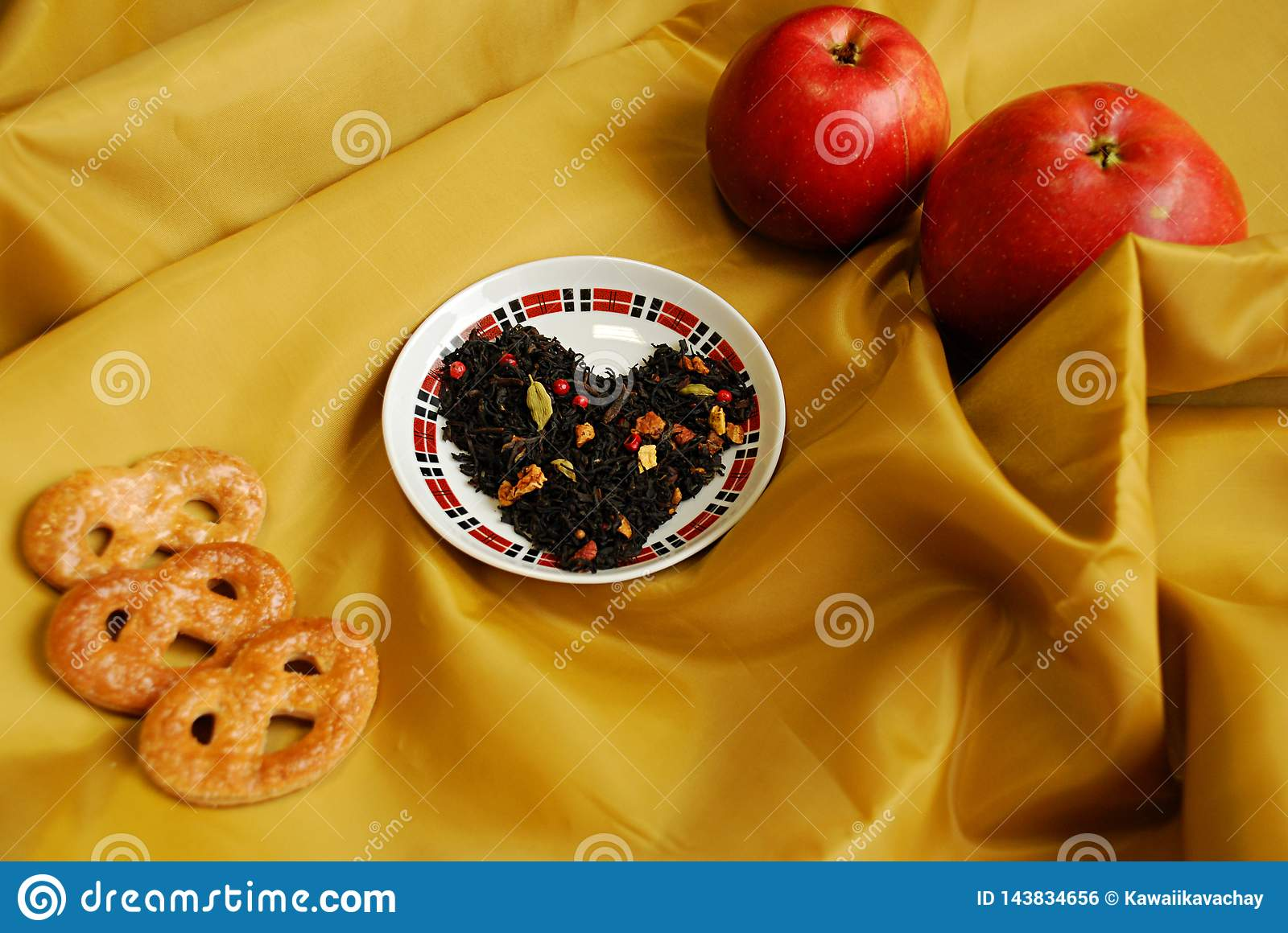 Exotic Chinese tea with buds of a clove, a coriander, slices of apples, oranges, pink pepper.