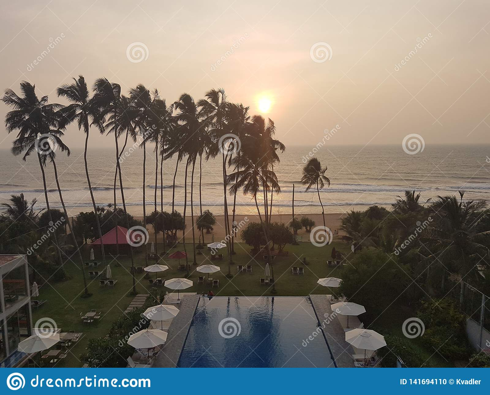 Exotic hotel with swimming pool and palms on the beach of ocean, Sri Lanka, beach