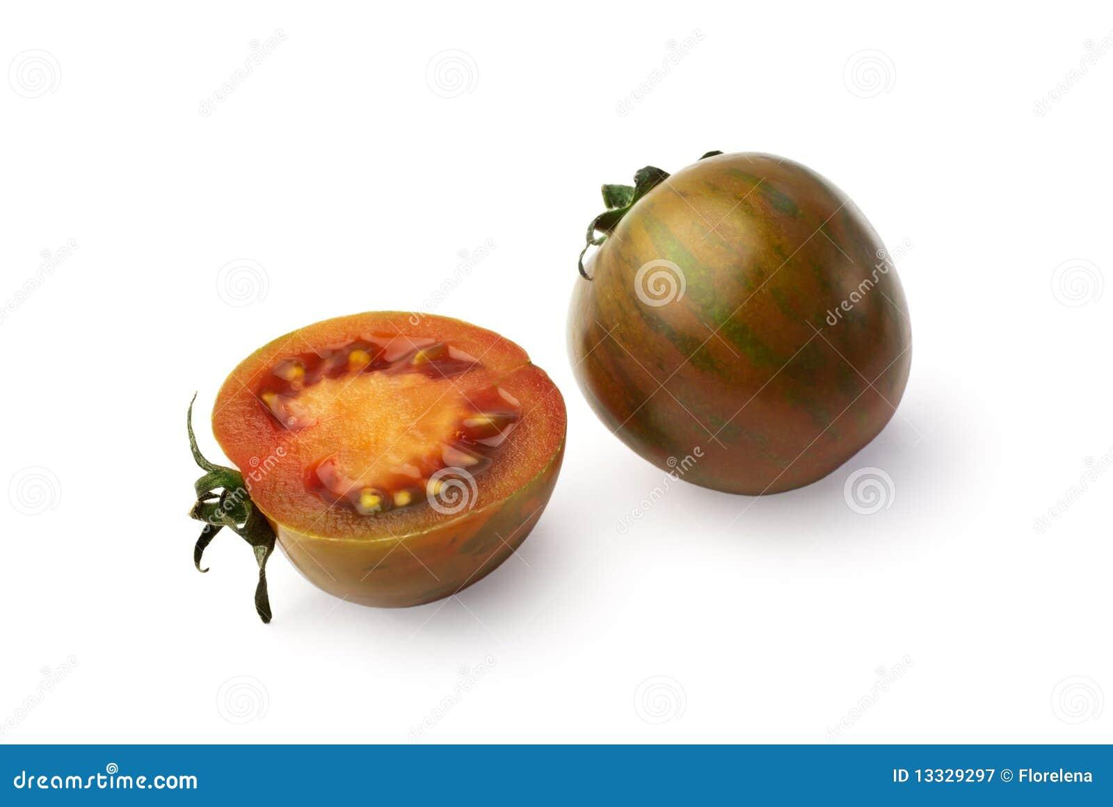 Exotische gestreepte tomaten die op wit worden geïsoleerdo