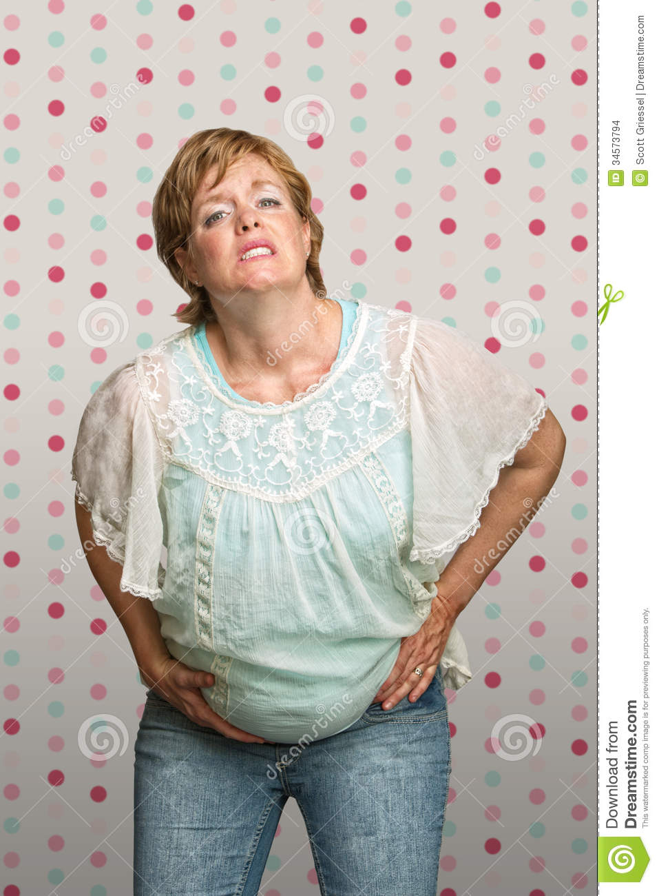 Expecting Woman in Pain stock photo. Image of birth, jeans ...