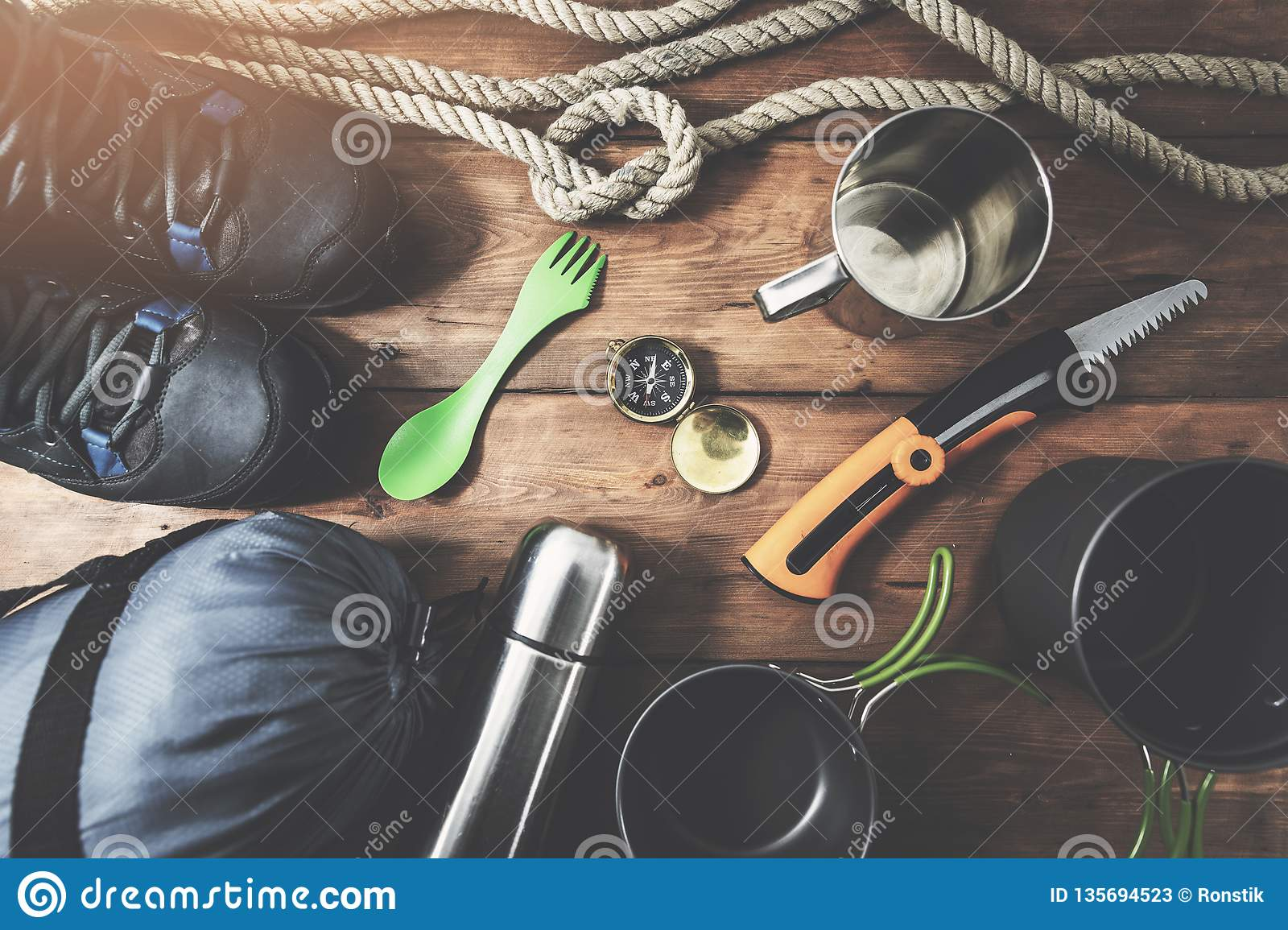 expedition camping equipment on wooden plank background