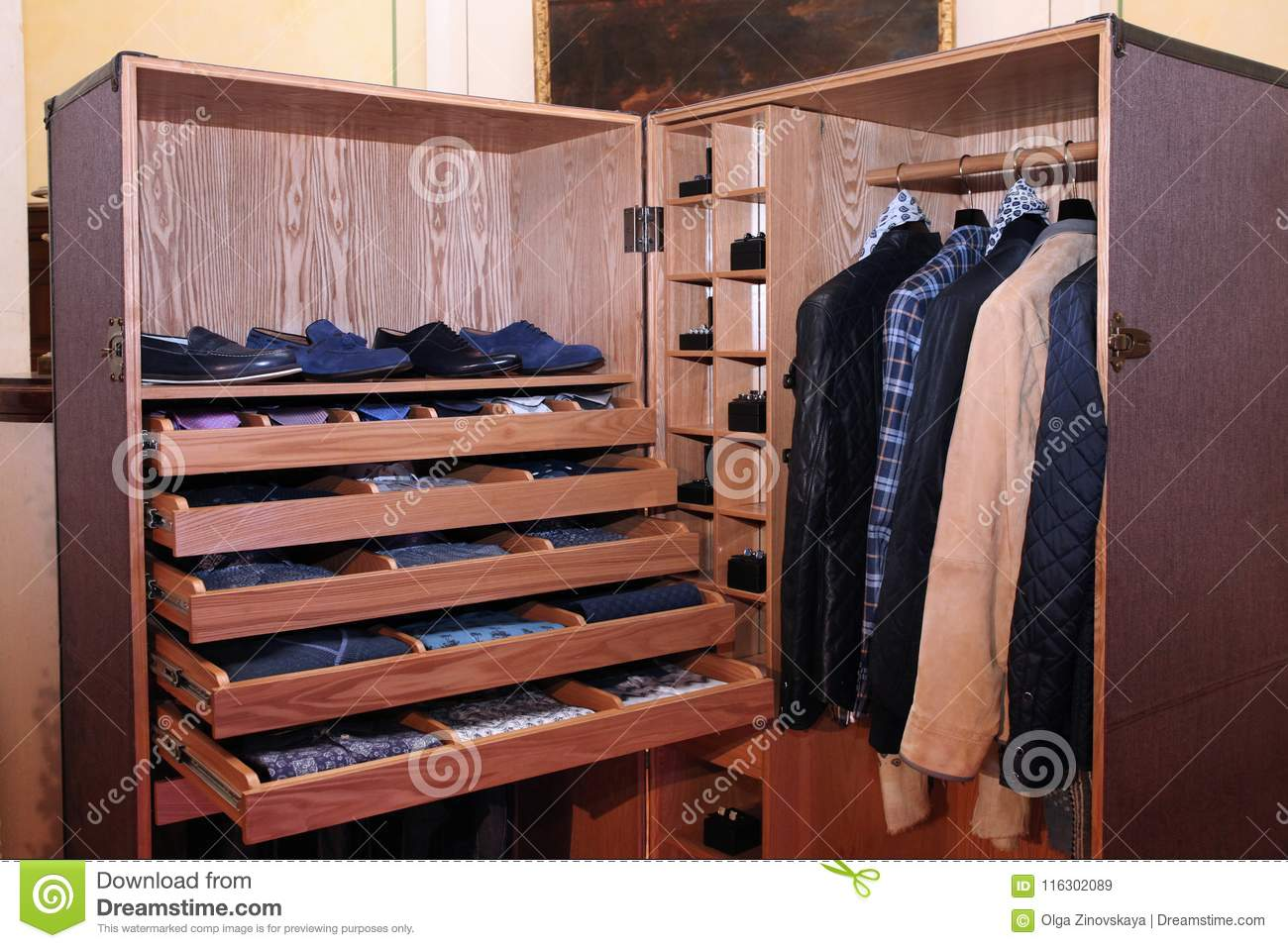 Expensive Fashionable Men`s Clothing And Shoes In An Unusual Closet Made Of  Wood