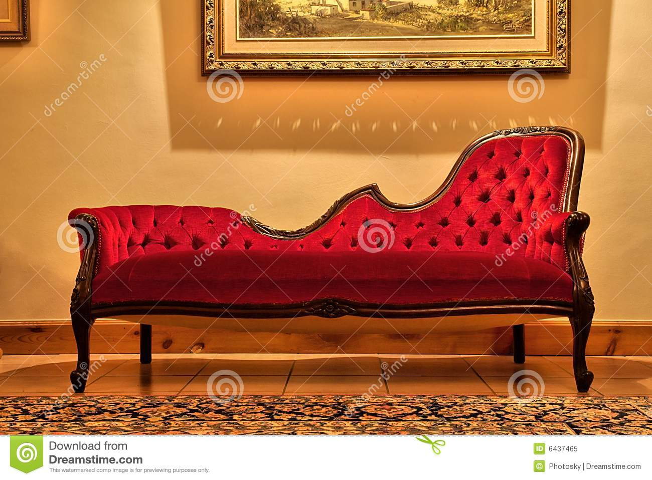 Expensive Red Sofa Under Painting Royalty Free Stock Photo