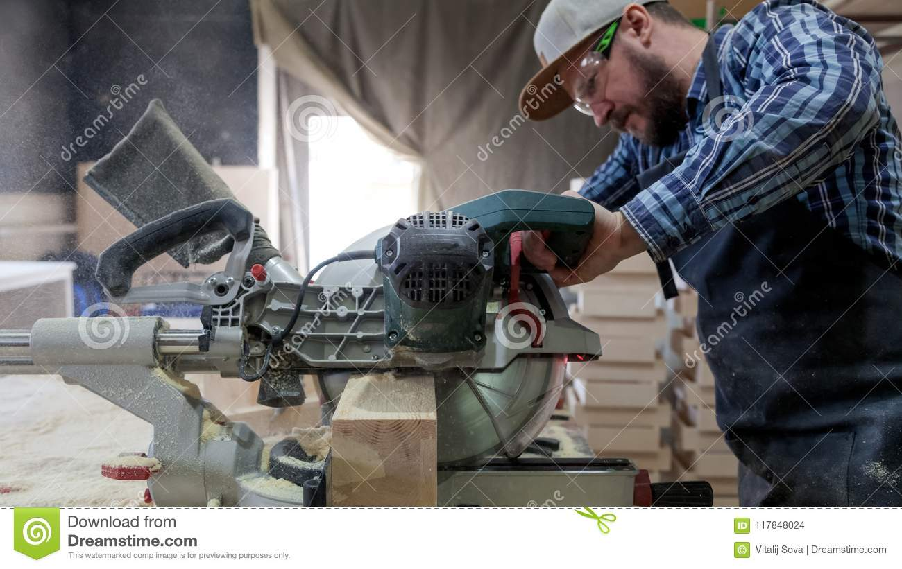 Experienced carpenter work with circular saw