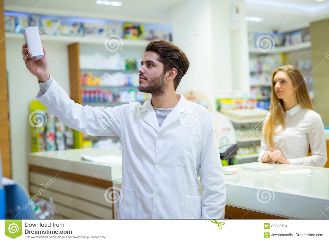 Experienced pharmacist counseling female customer in pharmacy