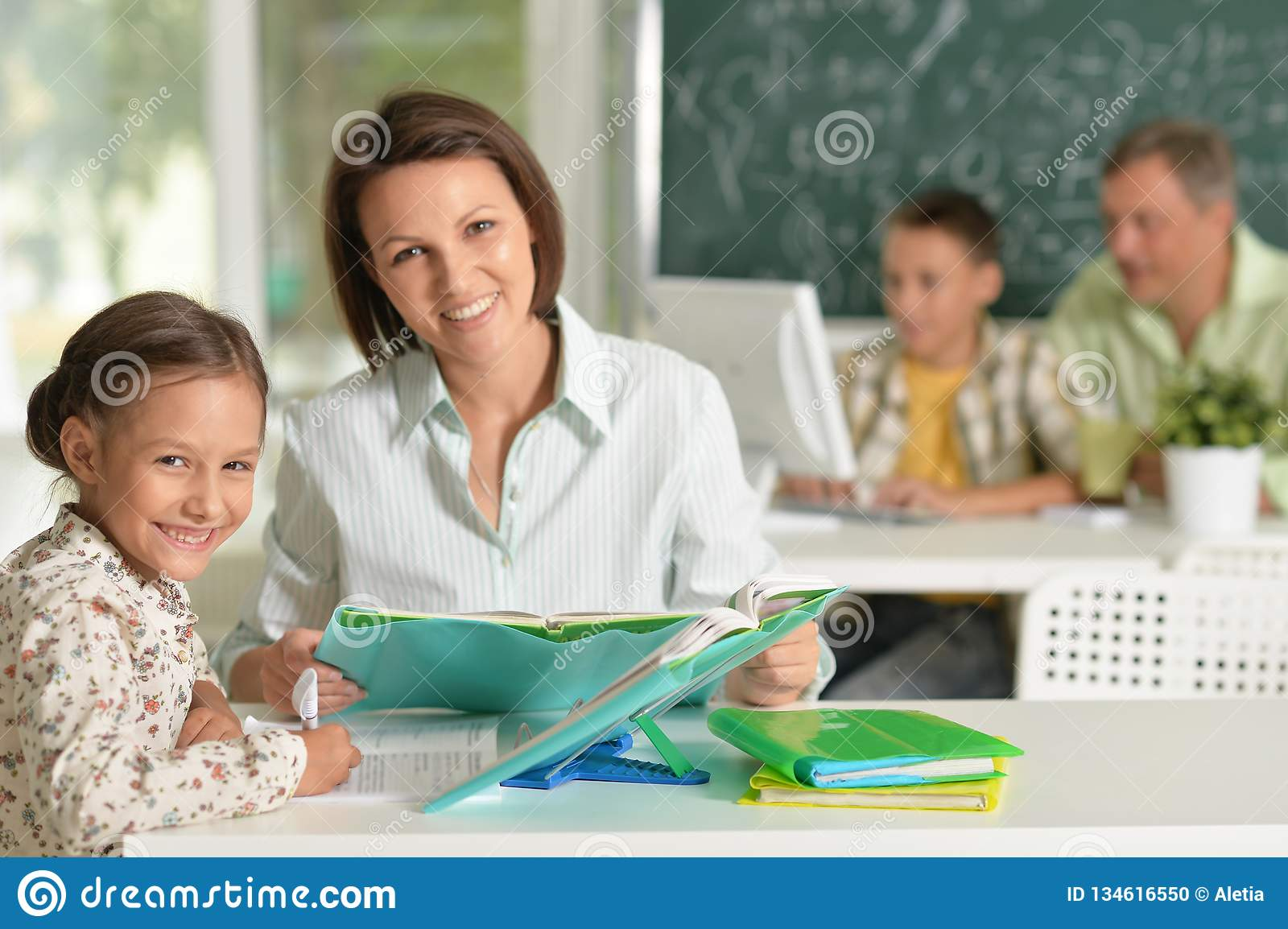 Portrait of experienced teachers working with children