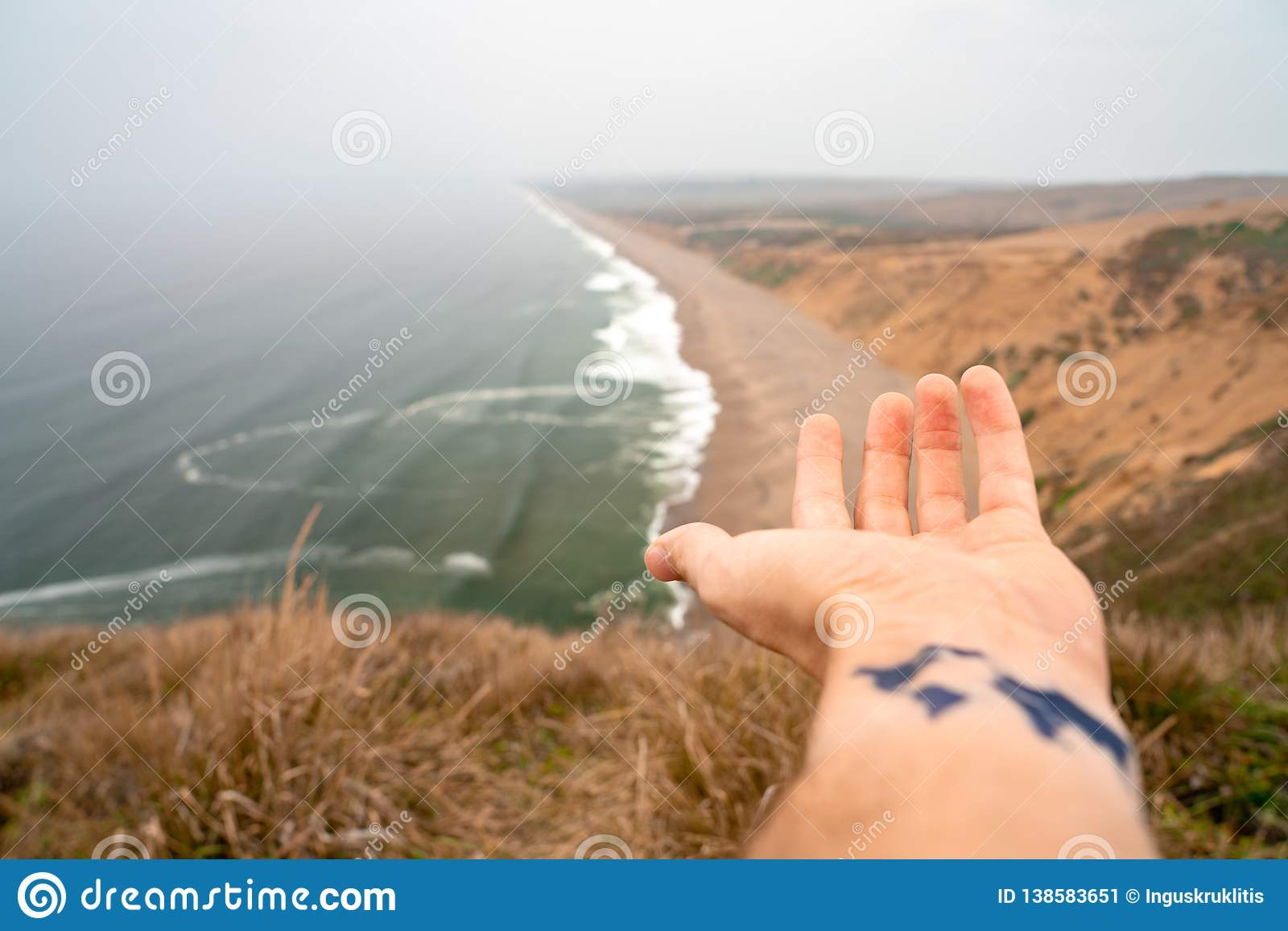 Young man with a tattoo of the world on his hand. Beautiful world.