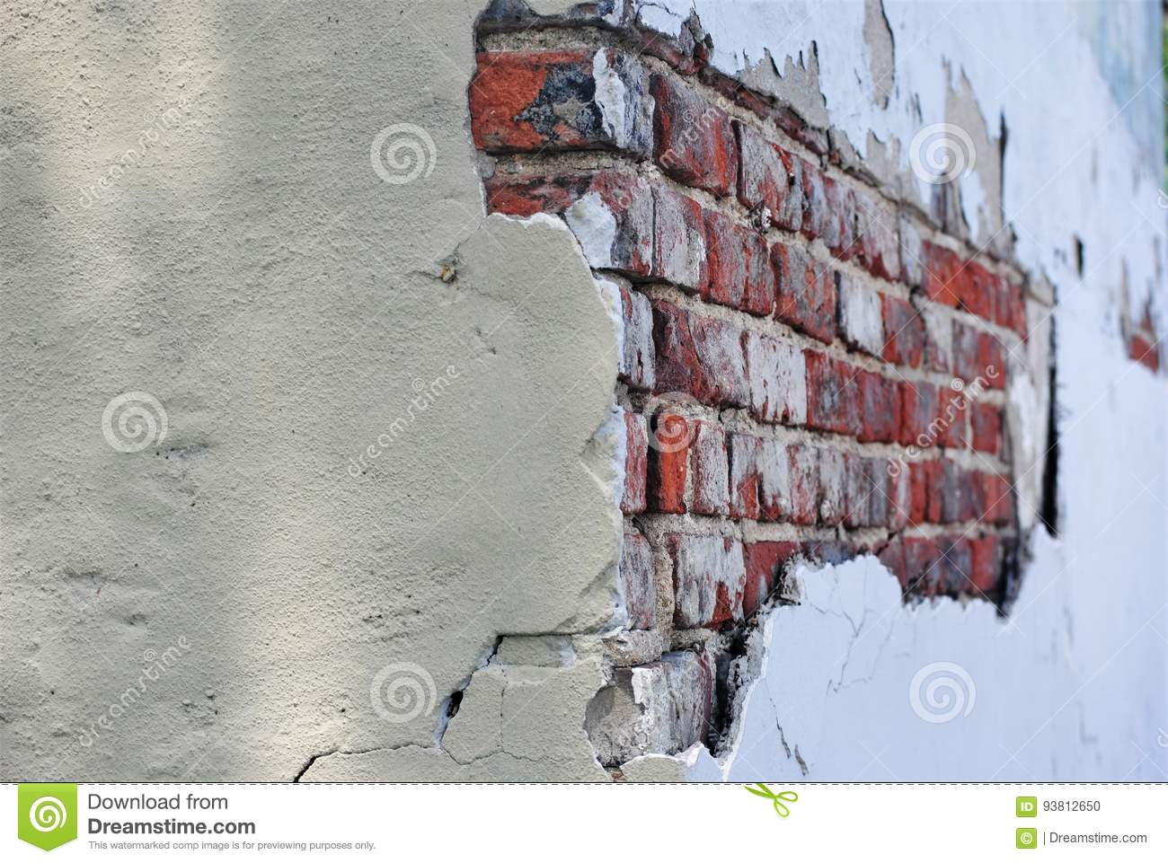 Exposed brick wall on old building
