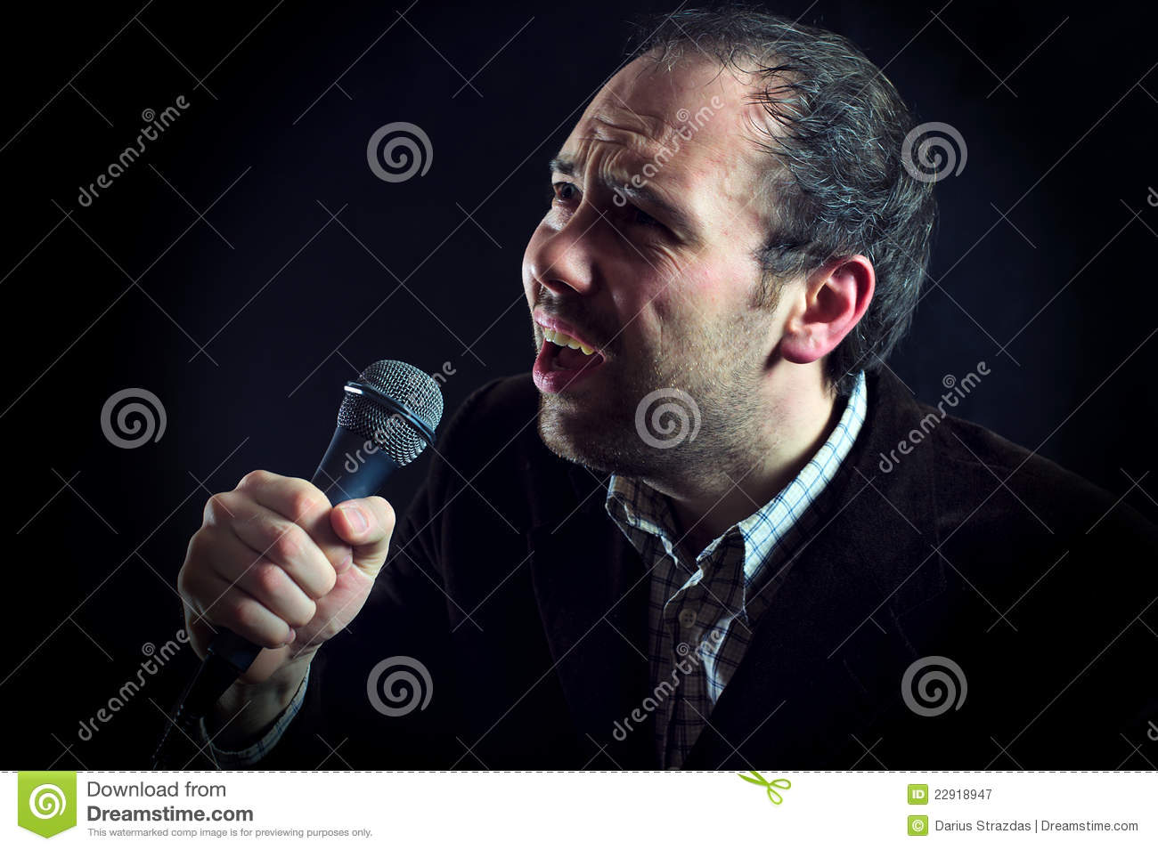 Expressive man singer with microphone