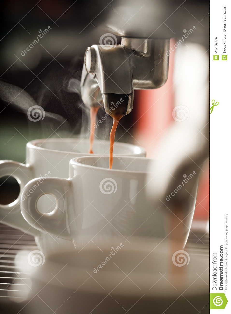 Expresso machine pouring two coffees