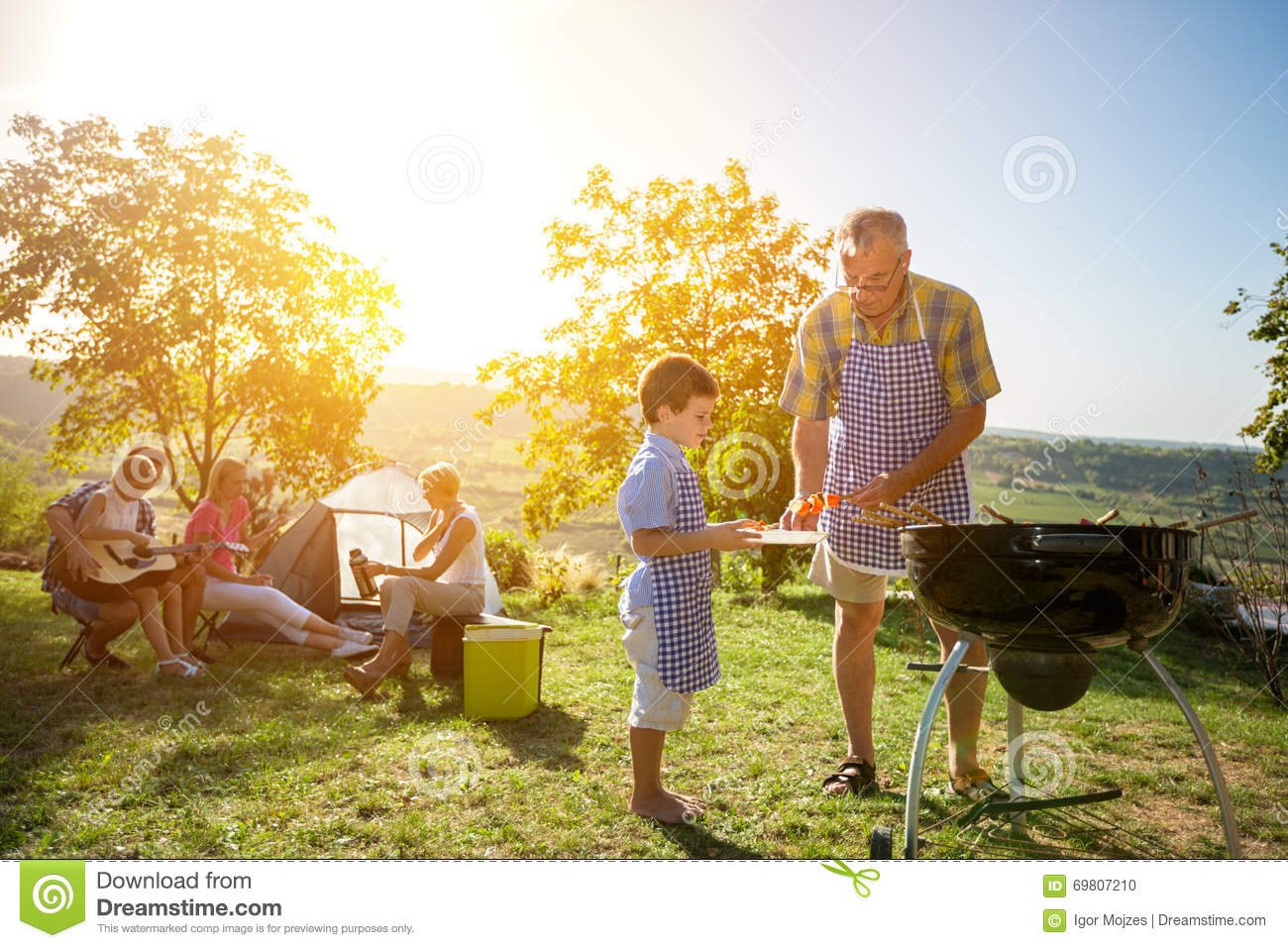 Extended family cooking barbecue