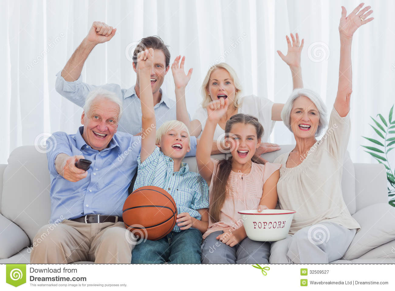 Extended Family Watching The Tv Royalty Free Stock