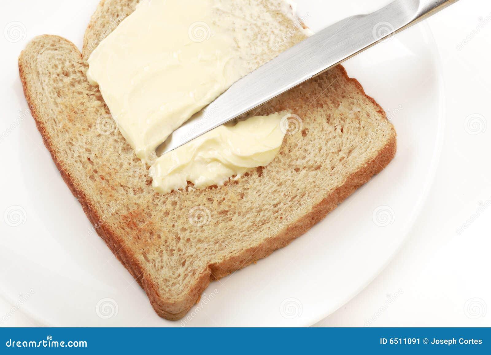 Extensi n untada con mantequilla imagen de archivo for Cuchillo de untar mantequilla
