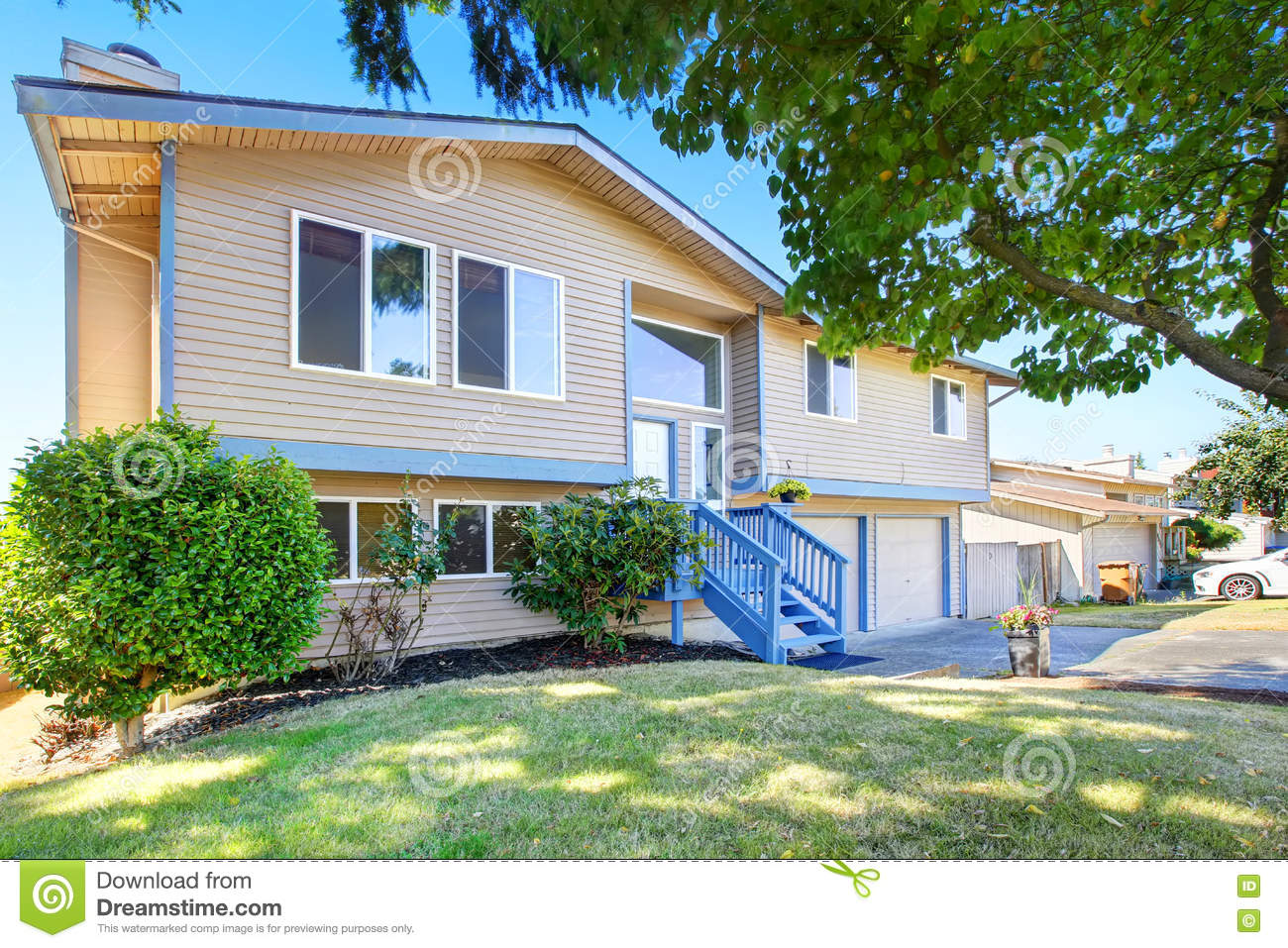 Exterior of beige siding house with blue trim stock photo for Blue siding house