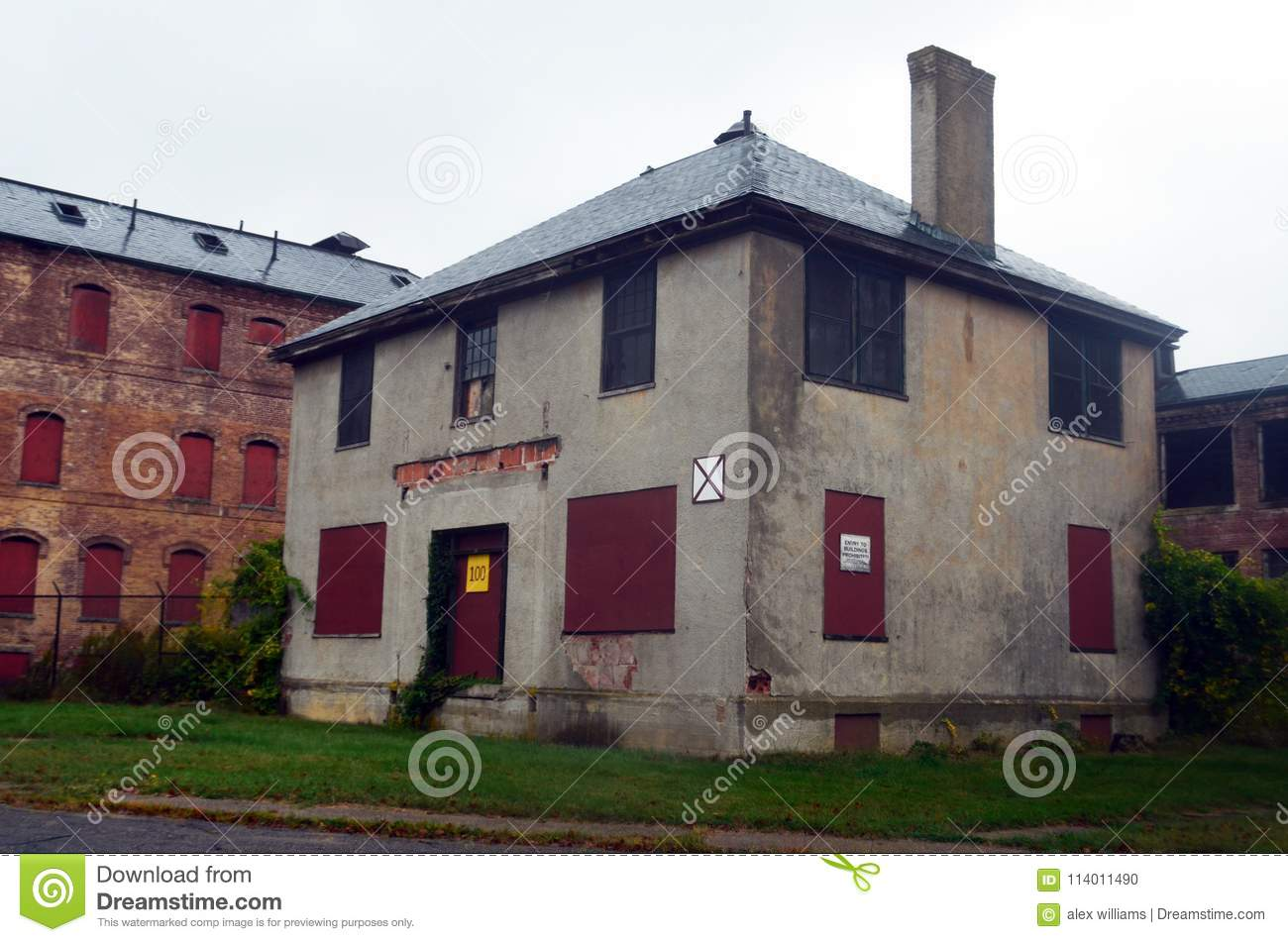 Exterior Of Boarded Up And Abandoned Brick Asylum Hospital Building With Broken Windows Stock Photo Image Of Abandoned Campus 114011490