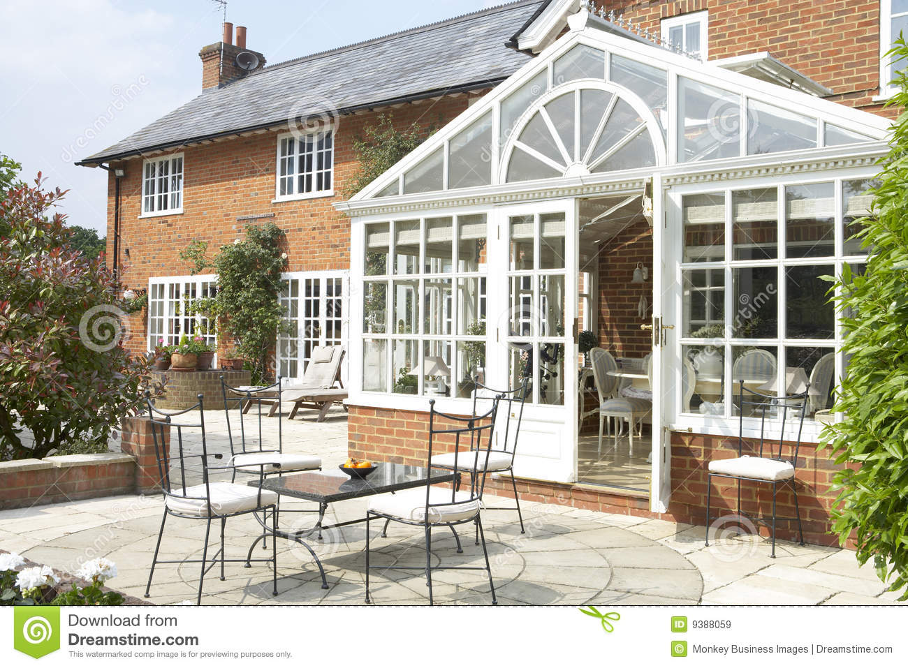 Exterior of house with conservatory and patio stock image for House plans with conservatory