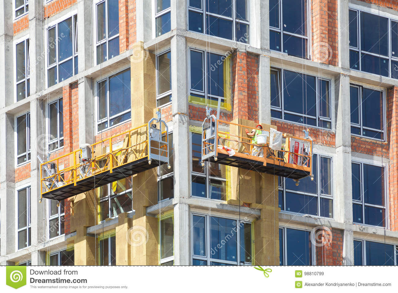 Exterior house wall heat insulation with mineral wool, building under construction
