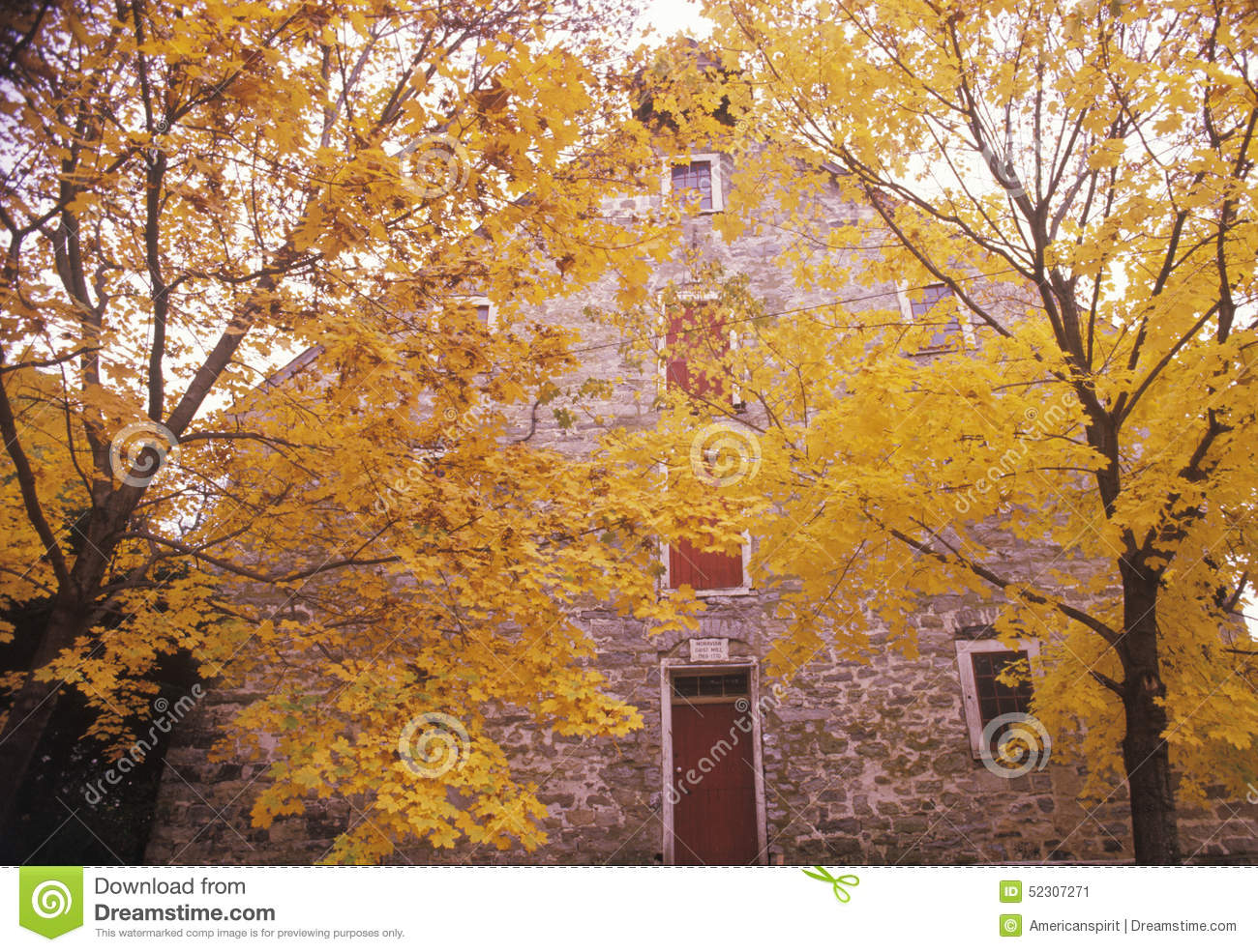 Exterior of moravian grist mill in autumn new jersey stock photo