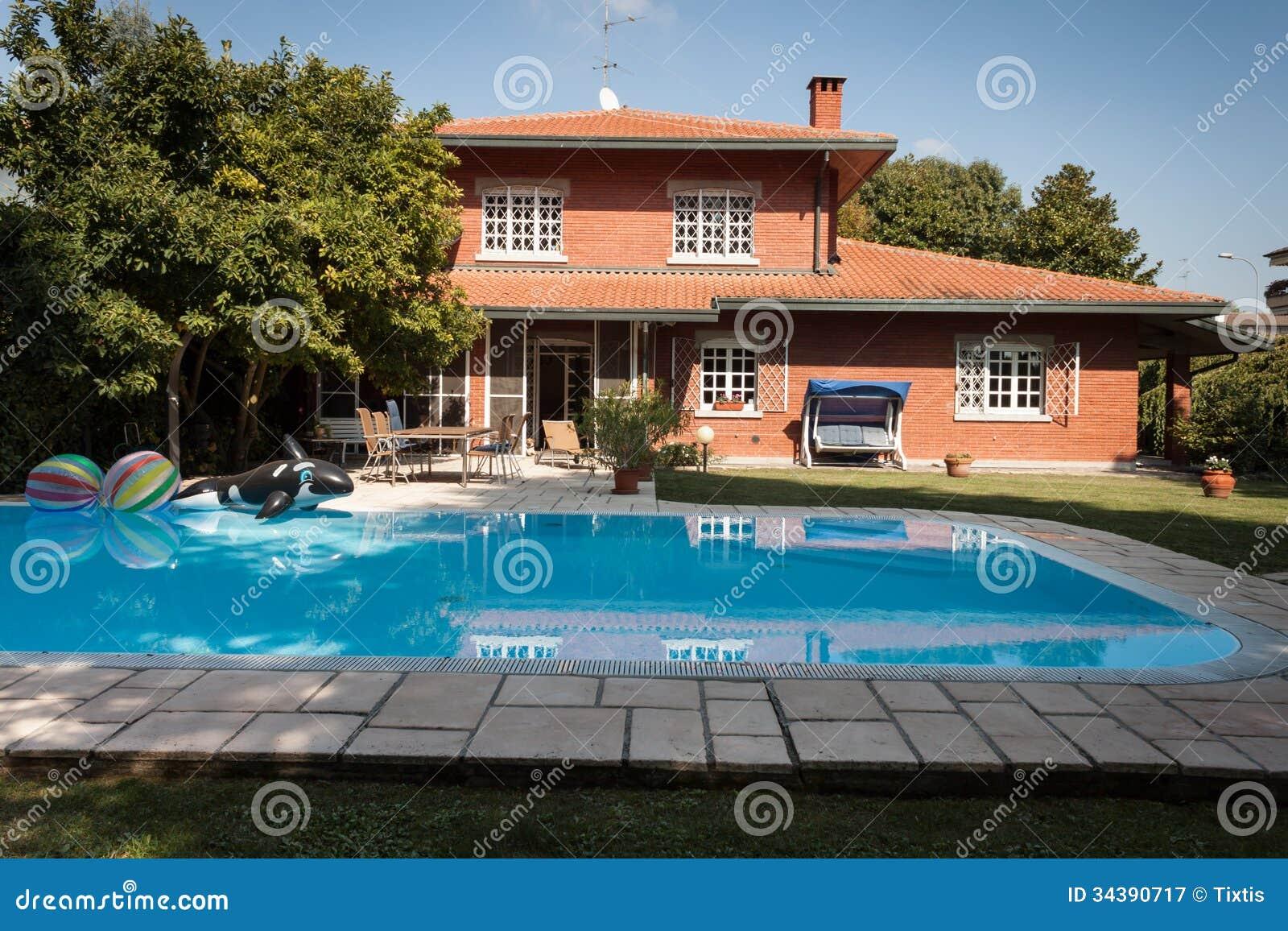 Exterior of a nice villa royalty free stock photography for Pool garden nice