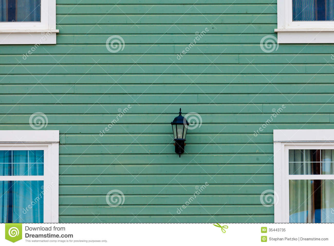 Exterior wall green siding center lamp and windows royalty for Exterior background