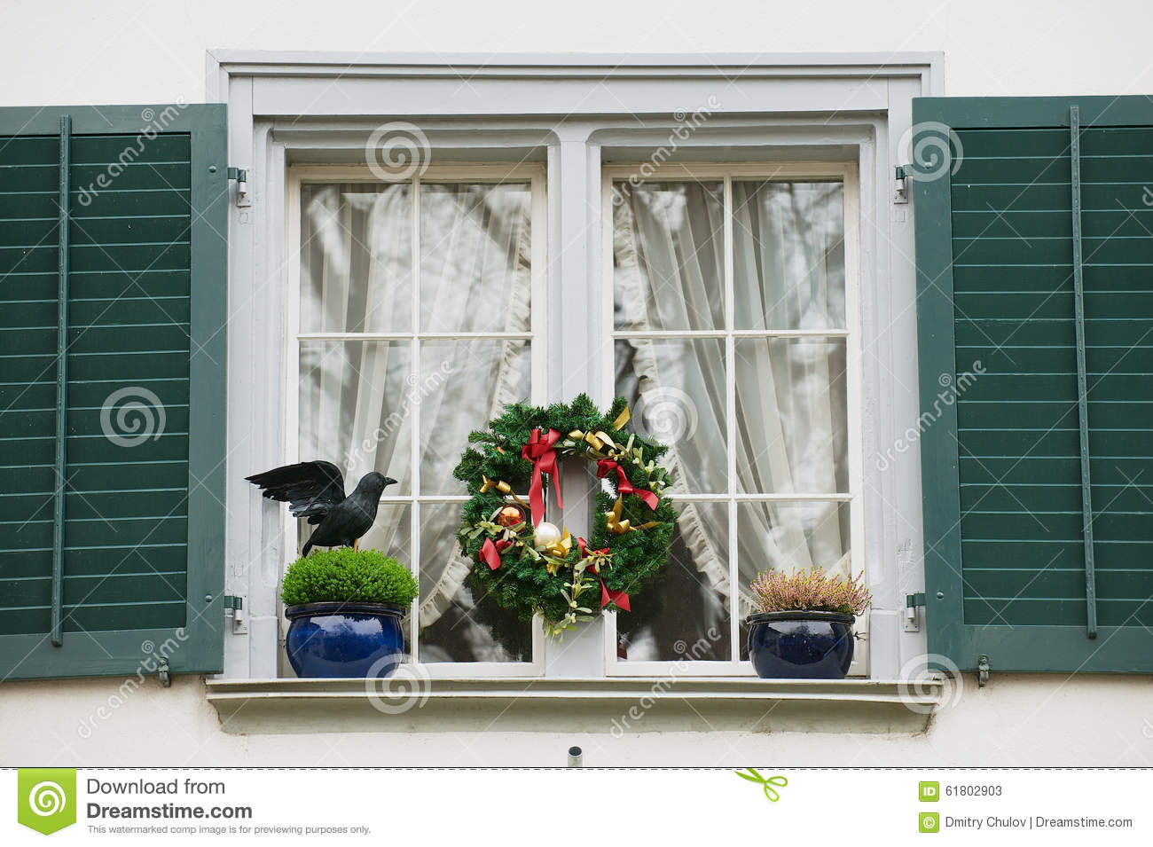 Exterior Of The Window With Christmas Decorations In