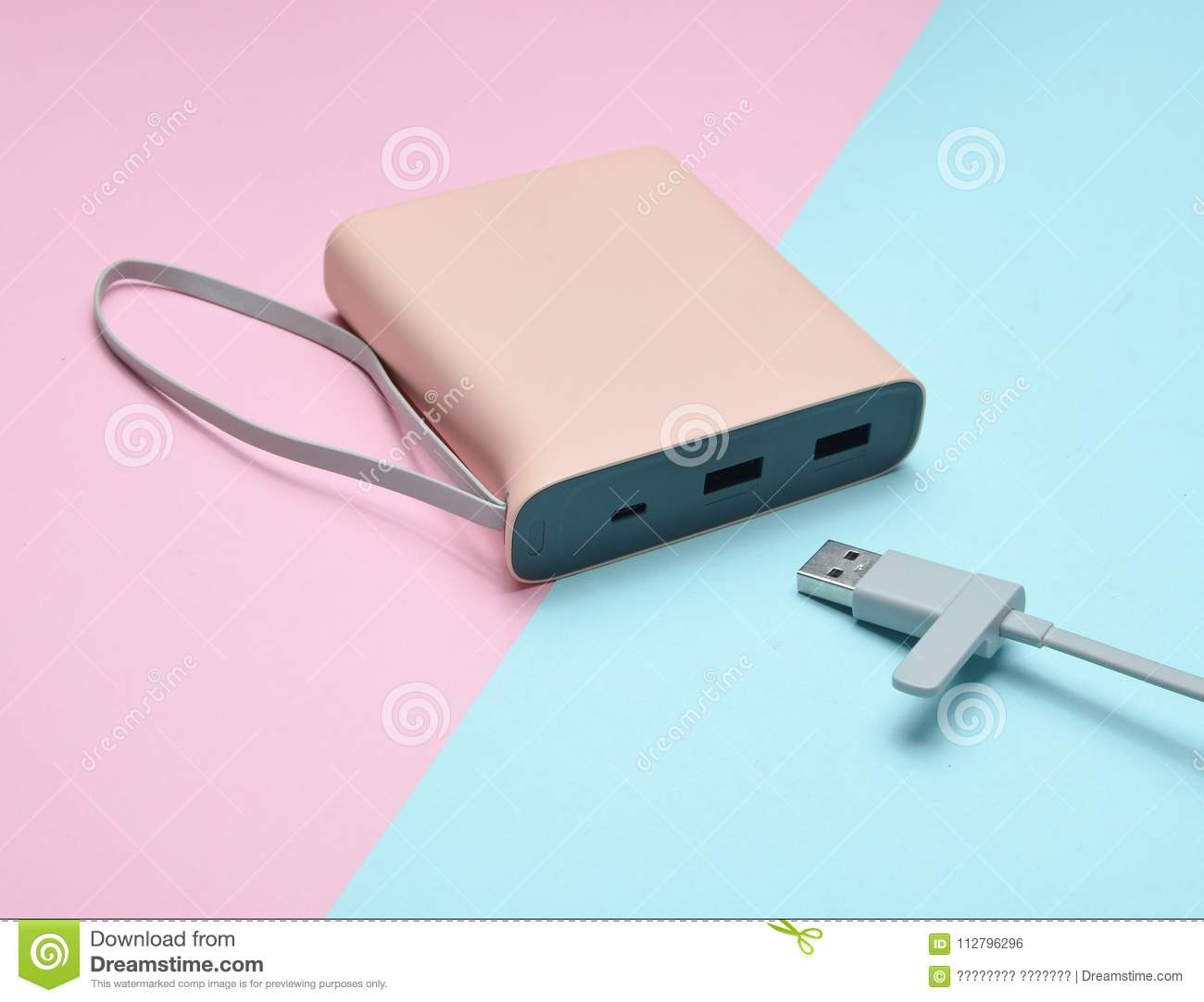 Download External Battery For Charging Smartphones And Gadgets With A Usb Cable Close-up On A Pink Blue Pastel Background. Power Bank. Stock Photo - Image of cable, electronic: 112796296