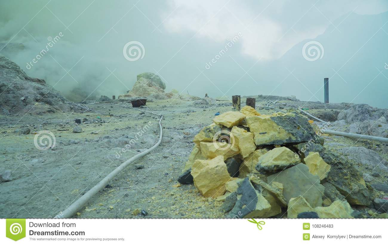 kawah ijen volcanic crater where sulfur is mined stock image