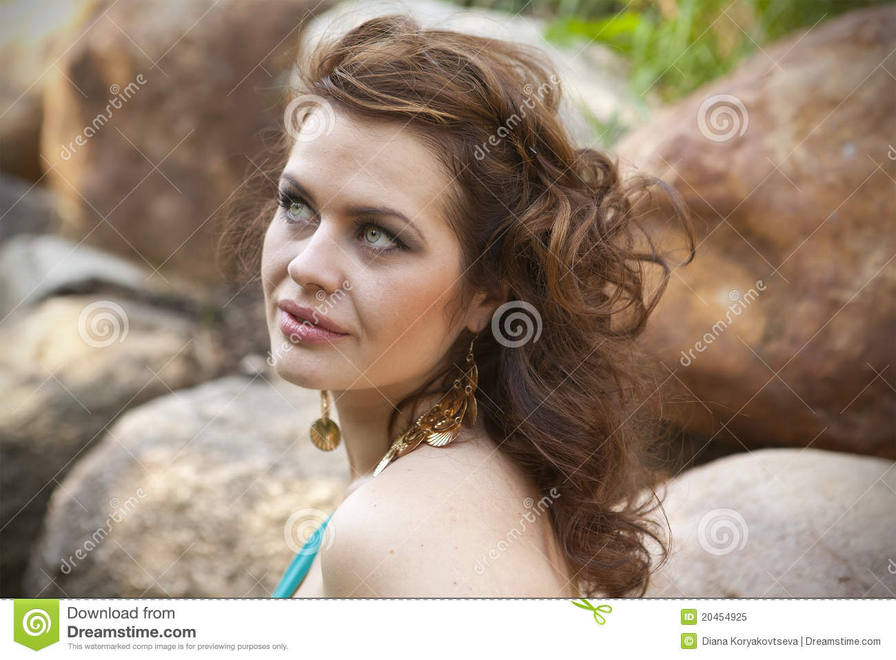 extraordinarily beautiful girl in a blue dress stock image