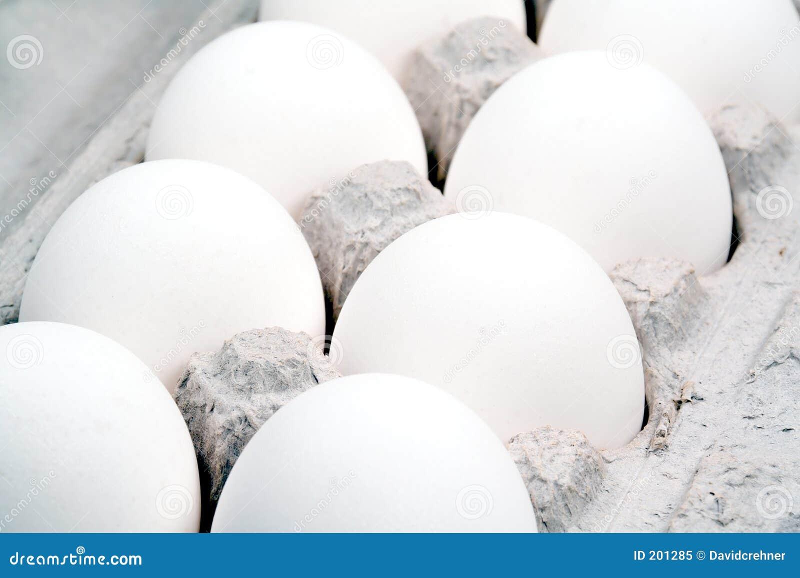 Extreme closeup of a dozen eggs