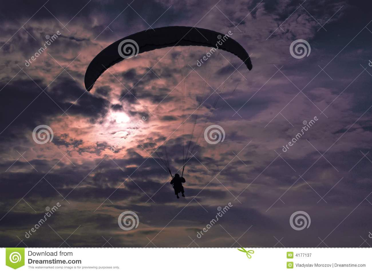 Extreme flying - paragliding at evening