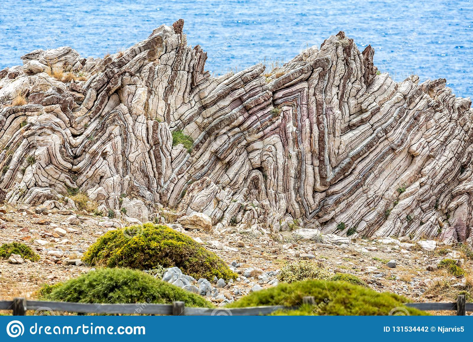 Extreme geological folds , anticlines and synclines, in Crete, Greece
