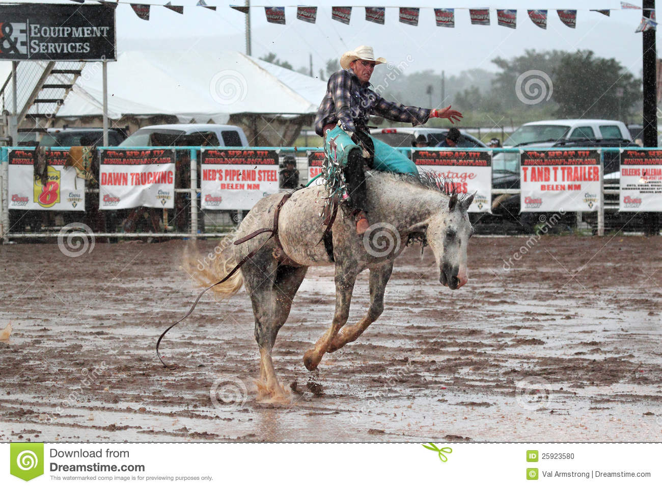 Beautiful Blond Cowgirl Riding A Palomino Horse In A