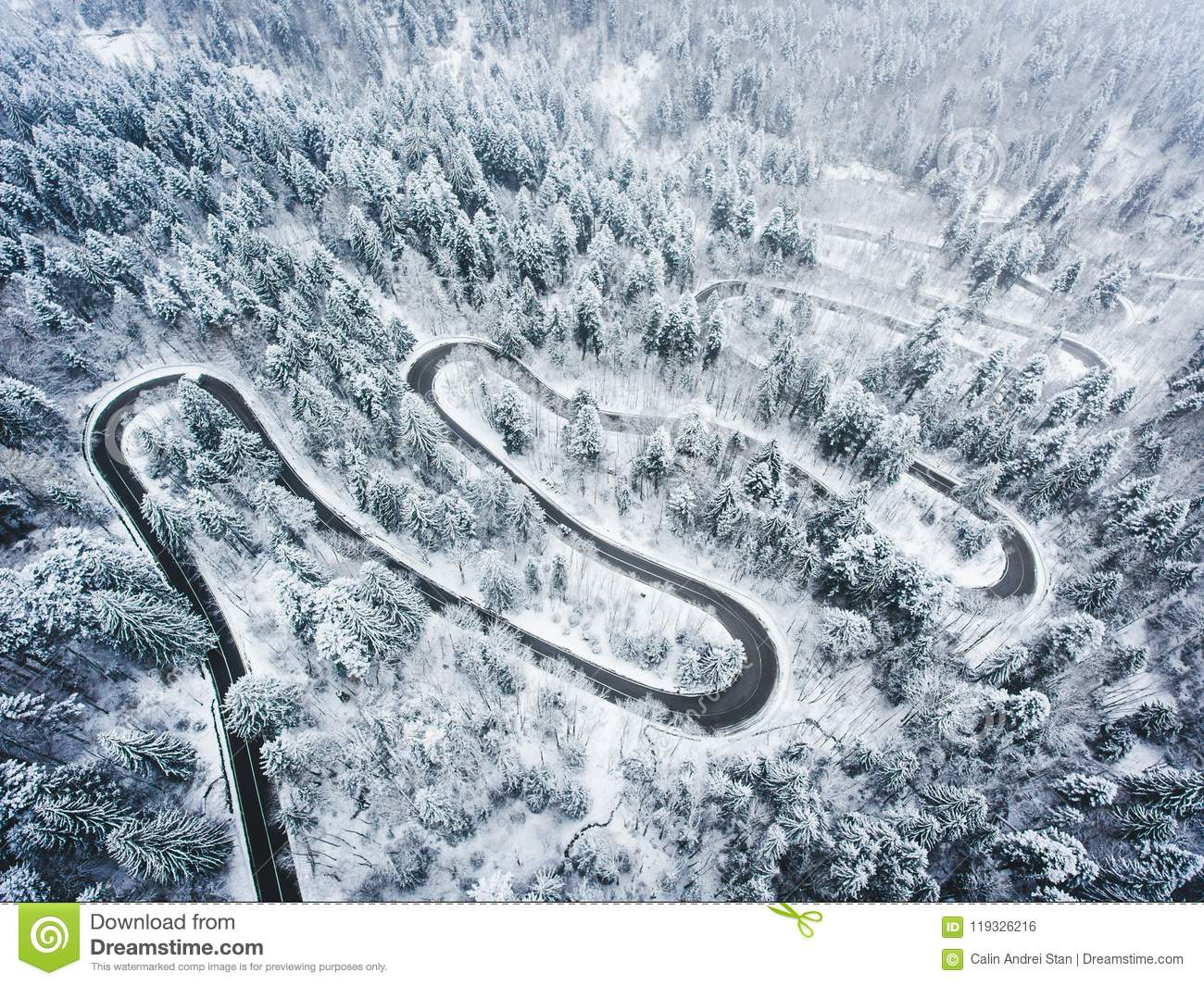 Extreme Winter Weather On A Winding Road In The Mountains
