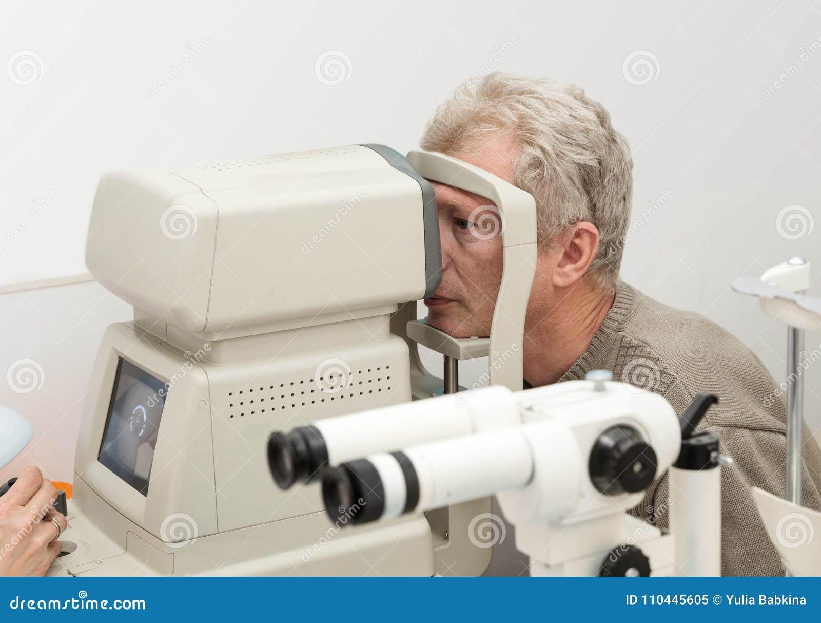 Eye Examination On Diagnostic Equipment Stock Image - Image of exam