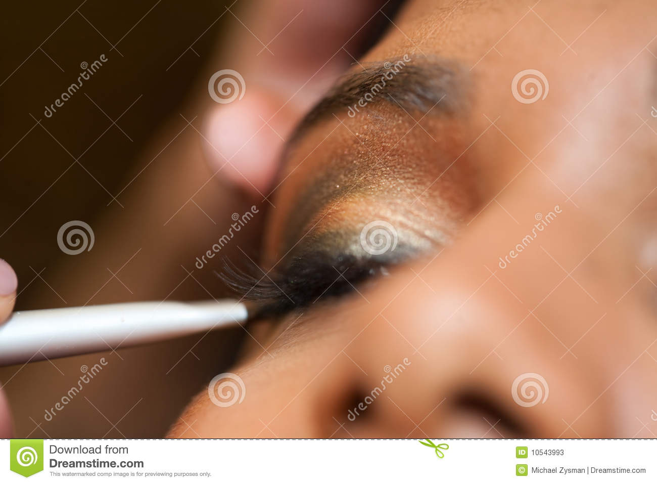 Young Indian Woman Has Eye Make Up Applied At A Salon
