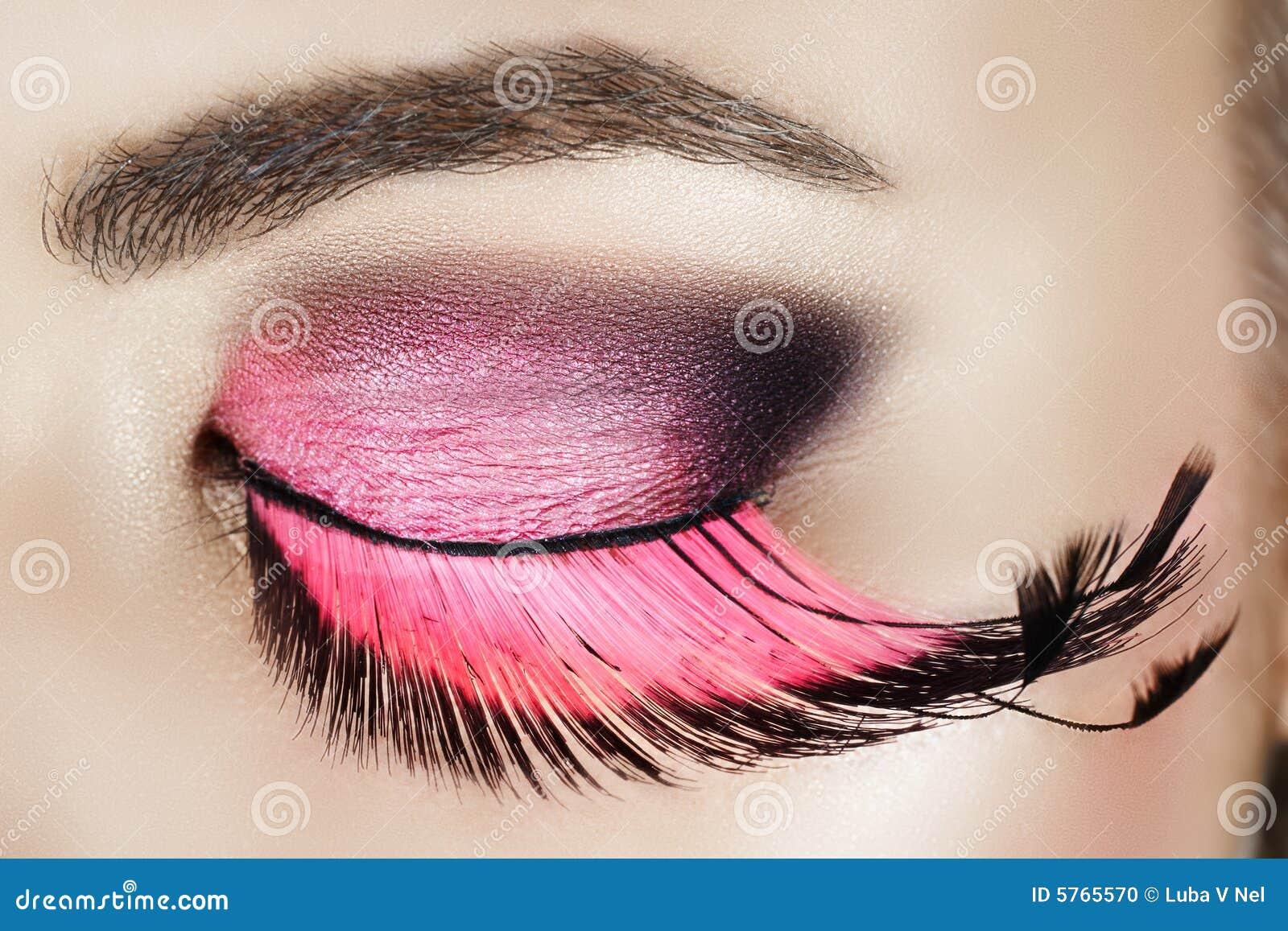 Eye with pink eyelashes
