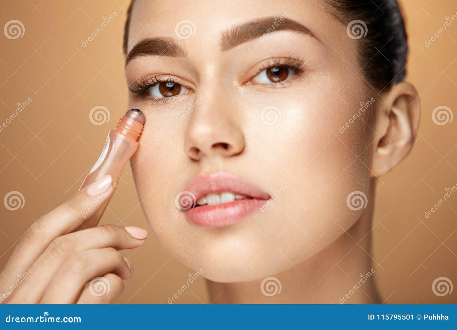 Eye Skin Beauty  Woman Using Cream Under Eyes Stock Image