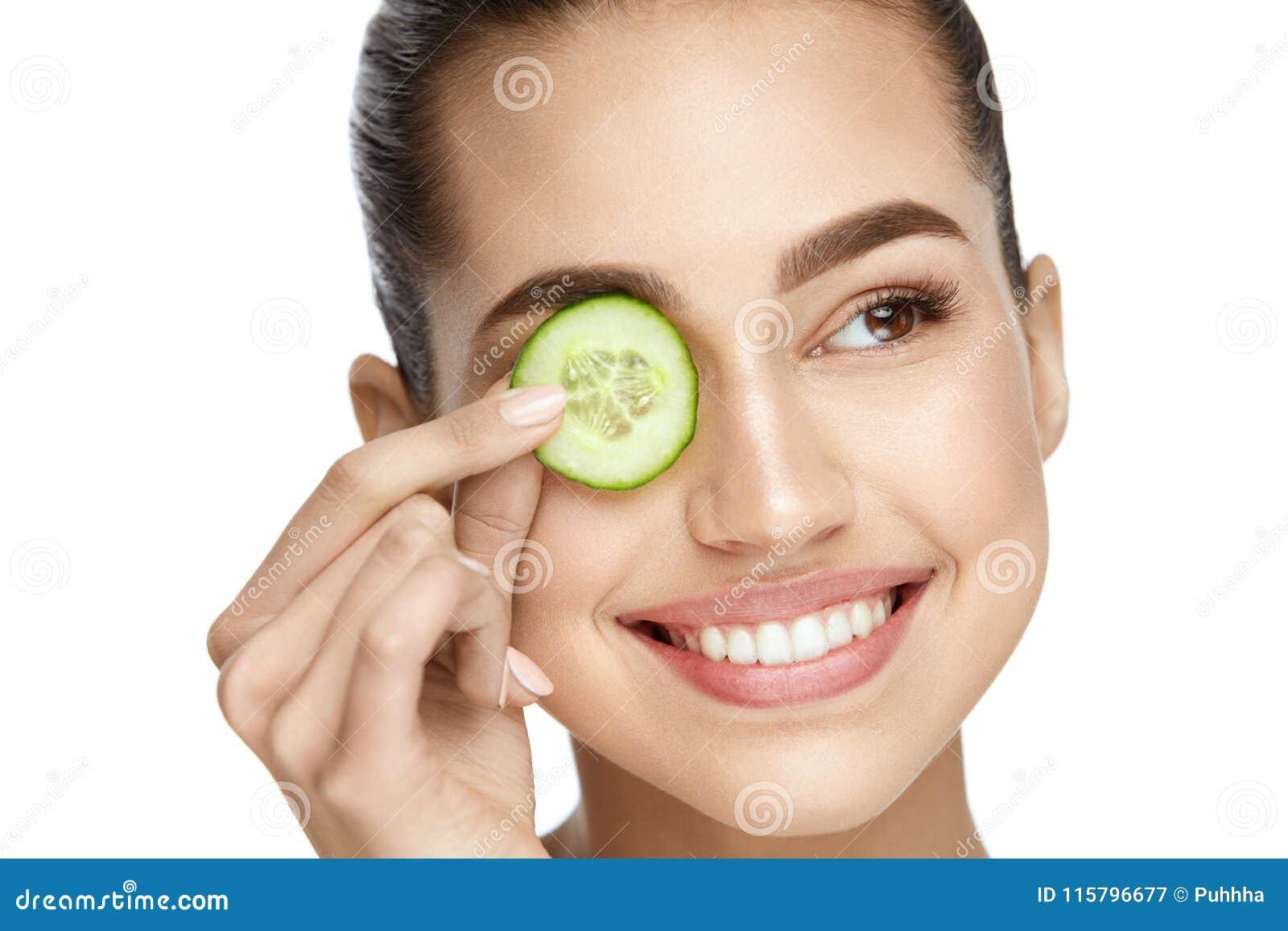 Girl using cucumber
